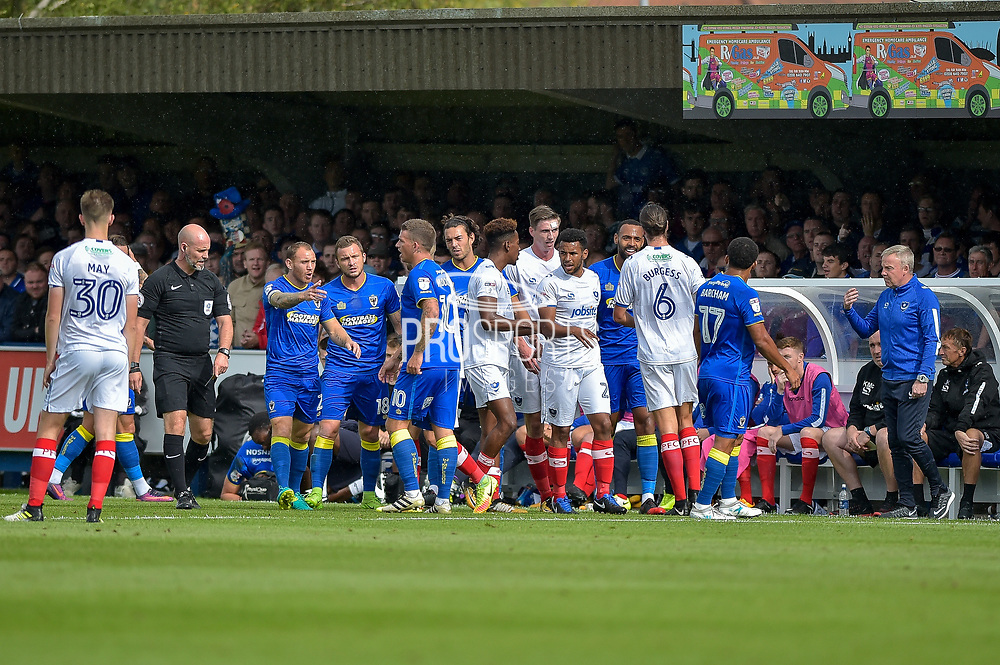 players come together after a foul on AFC Wimbledon Defender, Paul Robinson (6) during the EFL Sky Bet League 1 match between AFC Wimbledon and Portsmouth at the Cherry Red Records Stadium, Kingston, England on 9 September 2017. Photo by Adam Rivers.