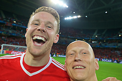 LILLE, FRANCE - Friday, July 1, 2016: Wales' Chris Gunter and physiotherapist Paul Harris celebrate after the 3-1 victory over Belgium during the UEFA Euro 2016 Championship Quarter-Final match at the Stade Pierre Mauroy. (Pic by David Rawcliffe/Propaganda)