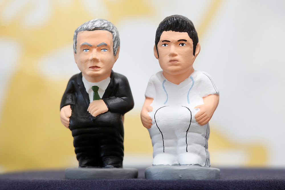 """November 10,  2010. A company in Torroella de Montgrí (Girona, Spain) called """"Caganer.com"""", which specializes in the production of """"caganers"""", unveiled today its new figurine for Christmas, Michael Jackson, Josn Lennon or prince Charles. .A """"Caganer"""" is a small figure from Catalonia, usually made of fired clay, which depicts as squatting person in the act defecating..""""Caganer"""" is Catalan for pooper. It forms part of one of the typical figures of the manger or """"Nativity"""" scene together with Mary, Joseph and the baby Jesus but hidden in a corner. It is a humorous figure, originally portraying a peasant wearing a """"barretina"""" (a red stocking hat), and seems to date from the 18th century when it was believed that the figure's deposits would fertilize the earth to bring a prosperous year. With the course of time, the original personage of this pooping figure was substituted with personalities from the political and sports worlds and other famous personalities..From left to right Real Madrid football team coach Xose Mourinho and player Cristiano Ronaldo, both from Portugal."""