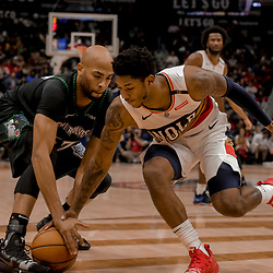 Dec 31, 2018; New Orleans, LA, USA; New Orleans Pelicans guard Elfrid Payton (4) defends Minnesota Timberwolves forward Taj Gibson (67) during the first quarter at the Smoothie King Center. Mandatory Credit: Derick E. Hingle-USA TODAY Sports