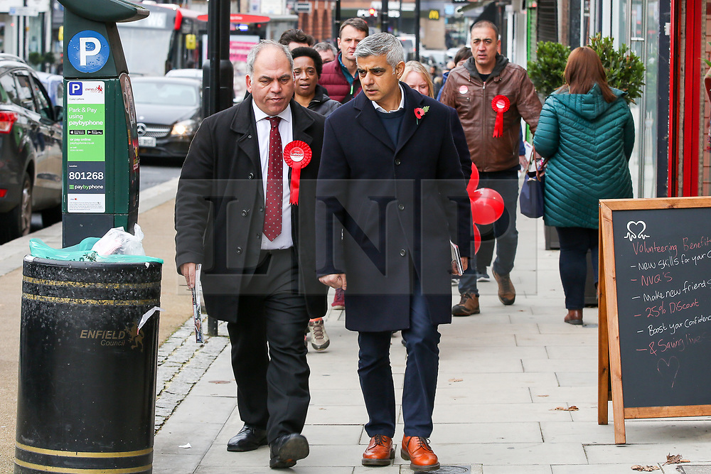 © Licensed to London News Pictures. 09/11/2019. London, UK. Mayor of London SADIQ KHAN (R) joins Labour Party MP for Enfield Southgate BAMBOS CHARALAMBOUS (L), party members and supporters campaigning for the general election in Palmers Green, Enfield, north London. Photo credit: Dinendra Haria/LNP