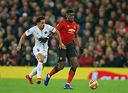 MANCHESTER, ENGLAND - Tuesday, February 12, 2019: Paris Saint-Germain's Marcos Aoás Corrêa 'Marquinhos' (L) and Manchester United's Paul Pogba during the UEFA Champions League Round of 16 1st Leg match between Manchester United FC and Paris Saint-Germain at Old Trafford. (Pic by David Rawcliffe/Propaganda)