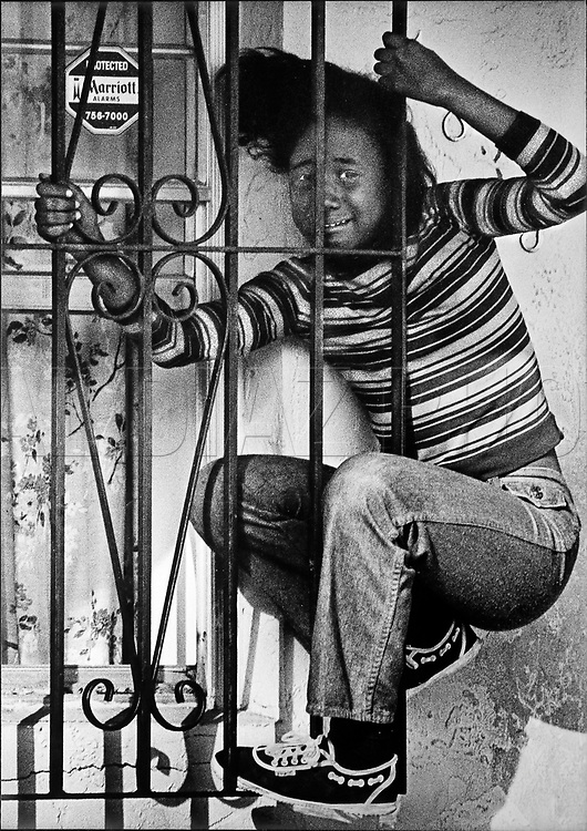 A young girl gets stuck behind bars while trying to squeeze through an open window of her own home. Miami-Dade fire rescue soon arrived to free her, 1983.