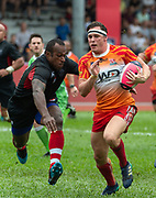 HONG KONG, HONG KONG SAR,CHINA. APRIL  21st, 2019. <br /> Global Rapid Rugby at Aberdeen Sports Ground Hong Kong.<br /> FWD South China Tigers win against the Asia Pacific dragons from Singapore.<br /> Lewis WARNER (R) with Sireli BOBO in pursuit (L).
