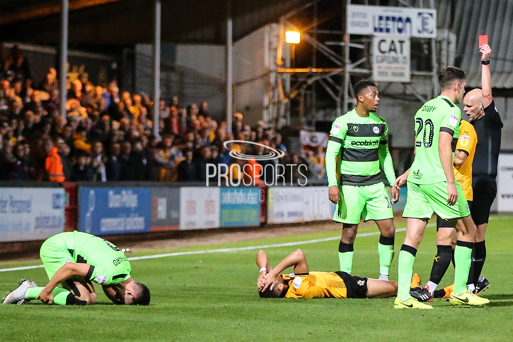 Cambridge United's Jake Carroll(3) is shown a red card, sent off for a bad challenge on Forest Green Rovers Liam Shephard(2) during the EFL Sky Bet League 2 match between Cambridge United and Forest Green Rovers at the Cambs Glass Stadium, Cambridge, England on 2 October 2018.