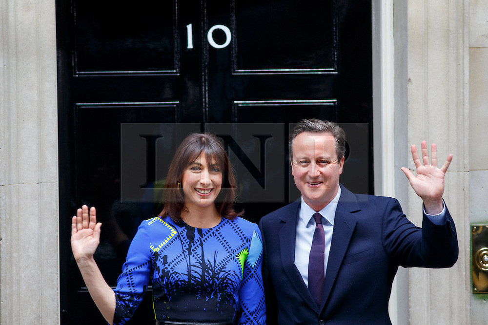 © Licensed to London News Pictures. 08/05/2015. LONDON, UK. Prime Minister and Conservatives leader David Cameron and wife Samantha Cameron returning to Downing Street after a visit to the Queen and obtaining a formal permission to form a Conservative majority government on Friday, 8 May 2015 following the 2015 General Election in the UK. Photo credit : Tolga Akmen/LNP