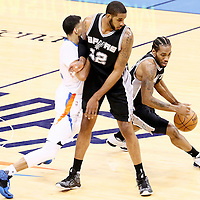 06 May 2016: San Antonio Spurs forward Kawhi Leonard (2) drives past Oklahoma City Thunder guard Andre Roberson (21) on a screen set by San Antonio Spurs forward LaMarcus Aldridge (12) during the San Antonio Spurs 100-96 victory over the Oklahoma City Thunder, during Game Three of the Western Conference Semifinals of the NBA Playoffs at the Chesapeake Energy Arena, Oklahoma City, Oklahoma, USA.