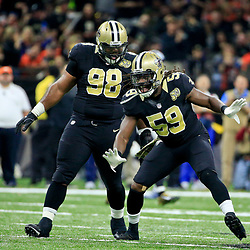 Nov 13, 2016; New Orleans, LA, USA;  New Orleans Saints outside linebacker Dannell Ellerbe (59) and defensive tackle Sheldon Rankins (98) celebrate after a sack during the second quarter of a game against the Denver Broncos at the Mercedes-Benz Superdome. Mandatory Credit: Derick E. Hingle-USA TODAY Sports
