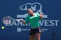 July 31, 2011; Stanford, CA, USA;  Serena Williams (USA) returns the ball against Marion Bartoli (FRA), not pictured, during the finals of the Bank of the West Classic women's tennis tournament at the Taube Family Tennis Stadium. Williams defeated Bartoli 7-5, 6-1.