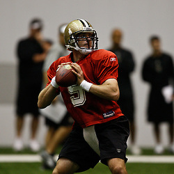 July 30, 2010; Metairie, LA, USA; New Orleans Saints quarterback Drew Brees (9) during a training camp practice at the New Orleans Saints indoor practice facility. Mandatory Credit: Derick E. Hingle