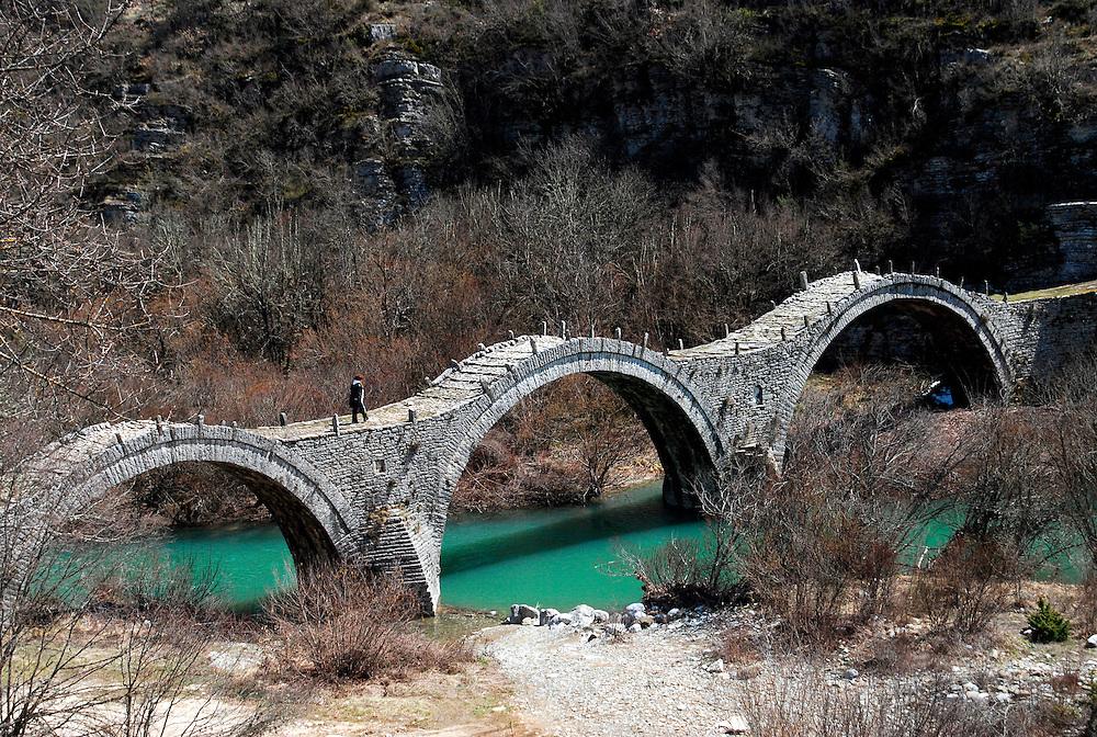 The stone bridge of Plakida at the village of Kipoi, one of Zagorochoria villages in central Zagori, Epirus region, northwestern Greece. Zagori is a region in the Pindus mountains in Epirus, northwestern Greece. It contains 45 villages known as Zagoria or Zagorochoria.