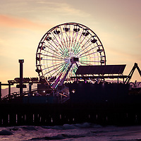 Santa Monica Pier Ferris Wheel retro photo at sunset. Santa Monica Pier is a Southern California landmark that has an amusement park with a ferris wheel, roller coaster, restaurants, and other attractions.