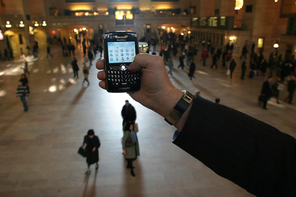 Paul Taylor reporter for the Financial Times checking new BlackBerry Mobile at the  Grand Central Station in Manhattan on Wednesday February 21 2007.....