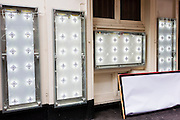 Changeable theatre production lightboxes, awaiting new posters outside the Gielgud theatre.