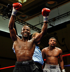 August 31, 2007; Atlantic City, NJ, USA; Shamone Alvarez (white trunks) and Germaine Sanders (black trunks) react at the final bell of their 12 round NABO Welterweight championship bout at Boardwalk Hall in Atlantic City, NJ.  Alvarez retained his title via unanimous decision.