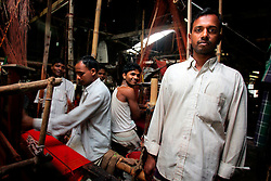BANGLADESH SIRAJGANJ SAJANTULI 1FEB07 - Sweatshop owner Amisul Rahman (30, R) poses with his workforce and some looms in rural Sirajganj. Records of an indigenous weaving industry based on handlooms producing cotton fabrics date back to the 13th century in this area...jre/Photo by Jiri Rezac..© Jiri Rezac 2007..Contact: +44 (0) 7050 110 417.Mobile:  +44 (0) 7801 337 683.Office:  +44 (0) 20 8968 9635..Email:   jiri@jirirezac.com.Web:    www.jirirezac.com..© All images Jiri Rezac 2007 - All rights reserved.