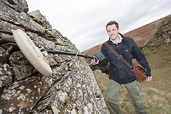 Historian Ashley Cowie with his metal detector at the cemetery wall, at the 'The Devil's Gold' in Dirlot, Caithness. He is doing a seven part series for The Scottish Sun on Scotland's treasure hunts at the end of April..©Michael Schofield.