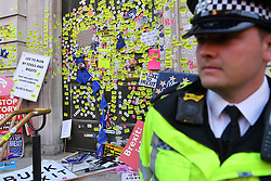 © Licensed to London News Pictures. 20/10/2018. London, UK. The Cabinet Offices, Whitehall covered in stickers at the conclusion of the People's Vote march that saw more than 600,000 protesters move through the streets of central London seeking a referendum on the final Brexit deal. Photo credit Guilhem Baker/LNP