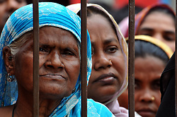 59591258  .People gather at a cemetery during a mass funeral in Dhaka, Bangladesh, May 1, 2013. The collapse of the eight-storey Rana Plaza building has left so far about 400 dead. Thousand of garment workers staged a procession to mark International Labour Day in Dhaka, demanding the death penalty for the owner of the building, 1 May, 2013. Photo by: i-Images.UK ONLY