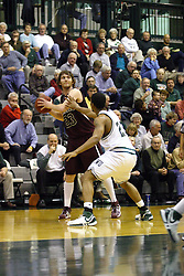 16 December 2006: Nate Hainje looks to pass out of the block set by Darius Gant. The University of Chicago Maroons upset  the Illinois Wesleyan Titans 64 - 60 at the Shirk Center in Bloomington Illinois.<br />