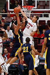 December 15, 2010; Stanford, CA, USA;  Stanford Cardinal forward Dwight Powell (33) blocks a shot by North Carolina A&T Aggies forward/center Thomas Coleman (23) during the first half at Maples Pavilion.