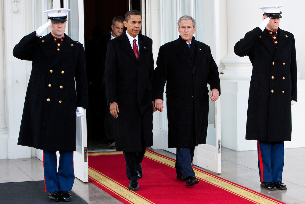WASHINGTON - JANUARY 20: President George W. Bush escorts President-elect Barack Obama out of the North Portico of the White House to the limousine they will share on their ride to the Capitol on January 20, 2009 in Washington, DC. President-elect Barack Obama will be sworn in as the country' 44th president at noon today. (Photo by Brendan Hoffman/Getty Images) *** George W. Bush;Barack Obama