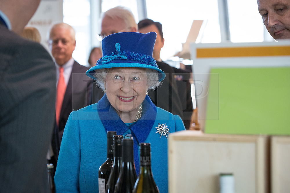 © Licensed to London News Pictures . 14/11/2013 . Manchester , UK . The Queen on tour around the building . Queen Elizabeth II and the Duke of Edinburgh visit the Coop building at 1 Angel Square , Manchester , this morning ( 14th November 2013 ) . Photo credit : Joel Goodman/LNP