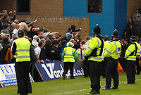 Photo: Ashley Pickering.<br /> Gillingham v Leeds United. Coca Cola League 1. 29/09/2007.<br /> Leeds fans are held back by Police as the match officials leave the pitch