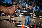 Herman Lategan - age 47 - Herman is pictured here with Trigger, participating in an equine assisted psychotherapy session at Montrose, 26 December, 2011..Equine assisted therapy at De Grendel farm Cape Town, through the Montrose clinic and foundation.The clinic treats patients with addiction illnesses such as alcoholism and eating disorders and the foundation is a charity that helps with street children from the townships...