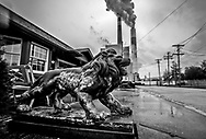 Decrative lion outside of a home near the Cheswick coal power plant in Pennsylvania's Allegheny County.