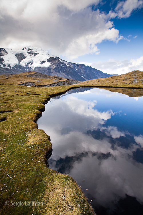 A high-altitude bog lies at 15,750'/4,800m and is across the way from Mt. Sunchuli  (17,200'/5,300m) and reflects the peaks of the Apolobamba Range in Bolivia during winter.  There is a mine on the flanks of this peak that has been exploited since the time of the Inca Empire.