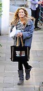 27.NOVEMBER.2009 - LONDON<br /> <br /> X-FACTOR FINALIST STACEY SOLOMAN ARRIVING AT THE X-FACTOR STUDIOS FOR REHEARSAL WITH A WONDER WOMEN BAG FOR THE LIVE SHOWS AND IS GREETED BY WAITING FANS.<br /> <br /> BYLINE: EDBIMAGEARCHIVE.COM<br /> <br /> *THIS IMAGE IS STRICTLY FOR UK NEWSPAPERS & MAGAZINES ONLY*<br /> *FOR WORLDWIDE SALES & WEB USE PLEASE CONTACT EDBIMAGEARCHIVE-0208 954 5968*