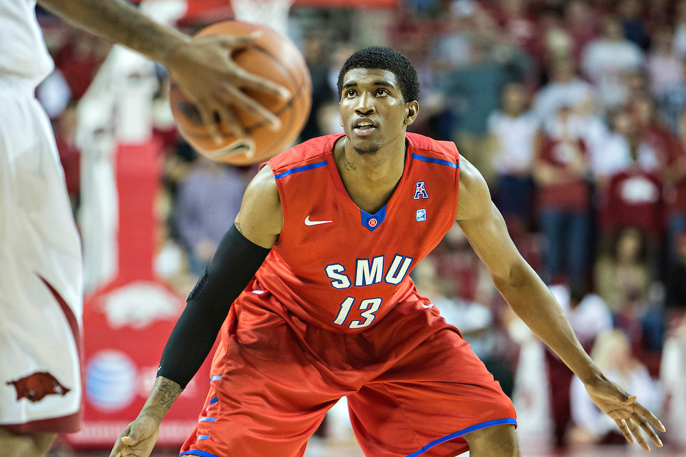 FAYETTEVILLE, AR - NOVEMBER 18:  Crandall Head #13 of the SMU Mustangs plays defense during a game against the Arkansas Razorbacks at Bud Walton Arena on November 18, 2013 in Fayetteville, Arkansas.  The Razorbacks defeated the Mustangs 89-78.  (Photo by Wesley Hitt/Getty Images) *** Local Caption *** Crandall Head