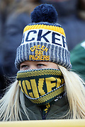 A Green Bay Packers fan wears a knit cap and scarf covering her face on a cold day during the 2017 NFL week 11 regular season football game against the Baltimore Ravens, Sunday, Nov. 19, 2017 in Green Bay, Wis. The Ravens won the game in a 23-0 shutout. (©Paul Anthony Spinelli)