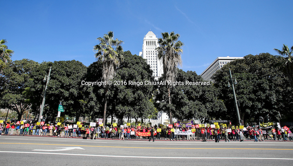 Protesters carry signs saying &quot;Save Peter Liang,&quot; and &quot;Accident Not Crime,&quot; in a rally Saturday, Feb. 20, 2016, in Los Angeles. Thousands protesters &mdash; most of them outraged Chinese Americans &mdash; are rallying in downtown Los Angeles in support of former NYPD Officer Peter Liang, charging the rookie cop was a scapegoat for critics of police brutality and was wrongly prosecuted for a tragic accident.(Photo by Ringo Chiu/PHOTOFORMULA.com)<br /> <br /> Usage Notes: This content is intended for editorial use only. For other uses, additional clearances may be required.