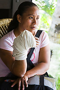 A woman with an injured hand waits patiently at the makeshift medical clinic in the Tabasco Governor's residence.