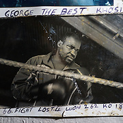 An old photograph of George Khosi, founder of the Hillbrow Boxing Club, annotated with his boxing record. After gunshot injuries put an end to his own boxing career, Khosi started the club to provide discipline, camaraderie and an activity away from the streets for young people from the community, as well as to provide a training ground for upcoming professional boxers. The club operates in the donated space of the forecourt of a disused petrol station in Hillbrow, one of Johannesburg, South Africa's most notorious neighbourhoods.