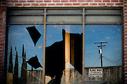 Broken windows and empty storefronts reflect tough times in Hood, Calif. September 17, 2009.