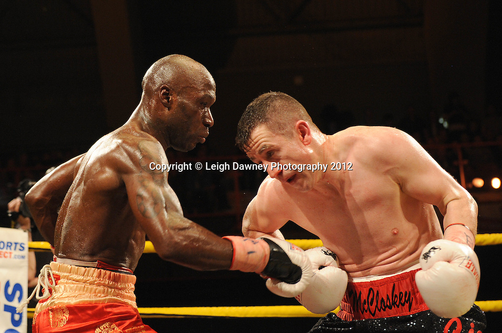 DeMarcus Corley (red shorts)  defeats Paul McCloskey after the referee Ian John-Lewis stops the fight in the eleventh round to claim the  Light Welterweight contest at Kings Hall, Belfast, Northern Ireland on Saturday 5th May 2012. Promoted by Prizefighter/Matchroom Sport. © Leigh Dawney Photography 2012.