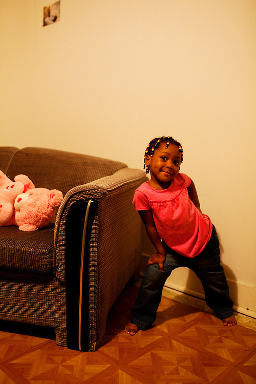 "Roger ""Winky"" Williams' daughter, Cameariyana, 4, poses in her home in the Baptist Town neighborhood of Greenwood, Mississippi on February 16, 2011."