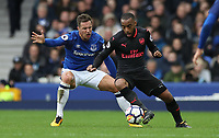 Football - 2017 / 2018 Premier League - Everton vs. Arsenal<br /> <br /> Lucas Perez of Arsenal and Phil Jagielka of Everton at Goodison Park.<br /> <br /> COLORSPORT/LYNNE CAMERON