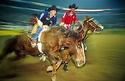 "14 DECEMBER 2002 - LAS VEGAS. NEVADA. USA: Jeff Collins, a bareback rider from Redfield, KS, finishes his ride at the National Finals Rodeo in Las Vegas, NV, Dec 14, 2002. The NFR is the ""super bowl"" of rodeo and draws hundreds of thousands of rodeo fans to Las Vegas for ten days every December. The rodeo is held at the Thomas and Mack center, which sells out for all ten performances. Other cowboy and western themed events take place around Las Vegas.  PHOTO BY JACK KURTZ"