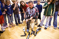 JEROME A. POLLOS/Press..Scott Rigsby shows 5th-grade students at Atlas Elementary how he attaches his different prosthetic legs for each event of the Ironman Triathlon.