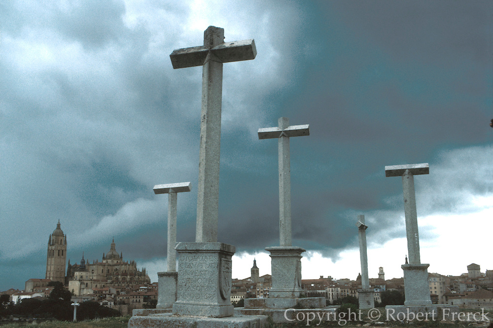 SPAIN, CASTILE and LEON, SEGOVIA the Cathedral and the city skyline with stone crosses in the foreground
