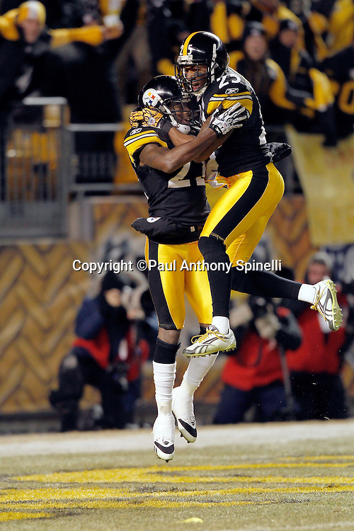 Pittsburgh Steelers cornerback William Gay (22) does an end zone celebration leap with Pittsburgh Steelers safety Ryan Clark (25) after Gay recovers a second quarter fumble and runs it back for a touchdown that gives the Steelers a 24-0 lead during the NFL 2011 AFC Championship playoff football game against the New York Jets on Sunday, January 23, 2011 in Pittsburgh, Pennsylvania. The Steelers won the game 24-19. (©Paul Anthony Spinelli)