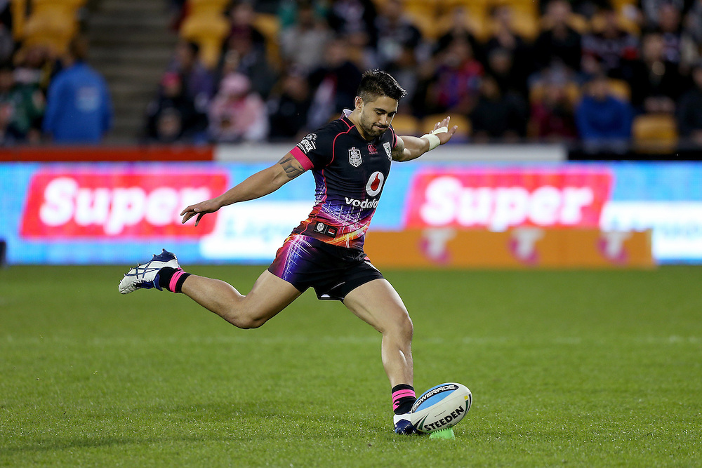 Shaun Johnson of the New Zealand Warriors takes a conversion kick during their round 12 NRL match at Mount Smart Stadium, Auckland on  Sunday, May 31, 2015. Credit: SNPA / David Rowland