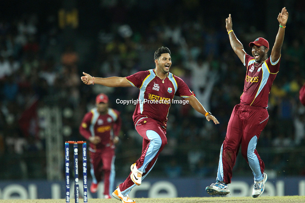 Ravi Rampaul of The West Indies and Darren Sammy (Captain) of The West Indies celebrates the wicket of Cameron White during the ICC World Twenty20 semi final match between Australia and The West Indies held at the Premadasa Stadium in Colombo, Sri Lanka on the 5th October 2012<br /> <br /> Photo by Ron Gaunt/SPORTZPICS