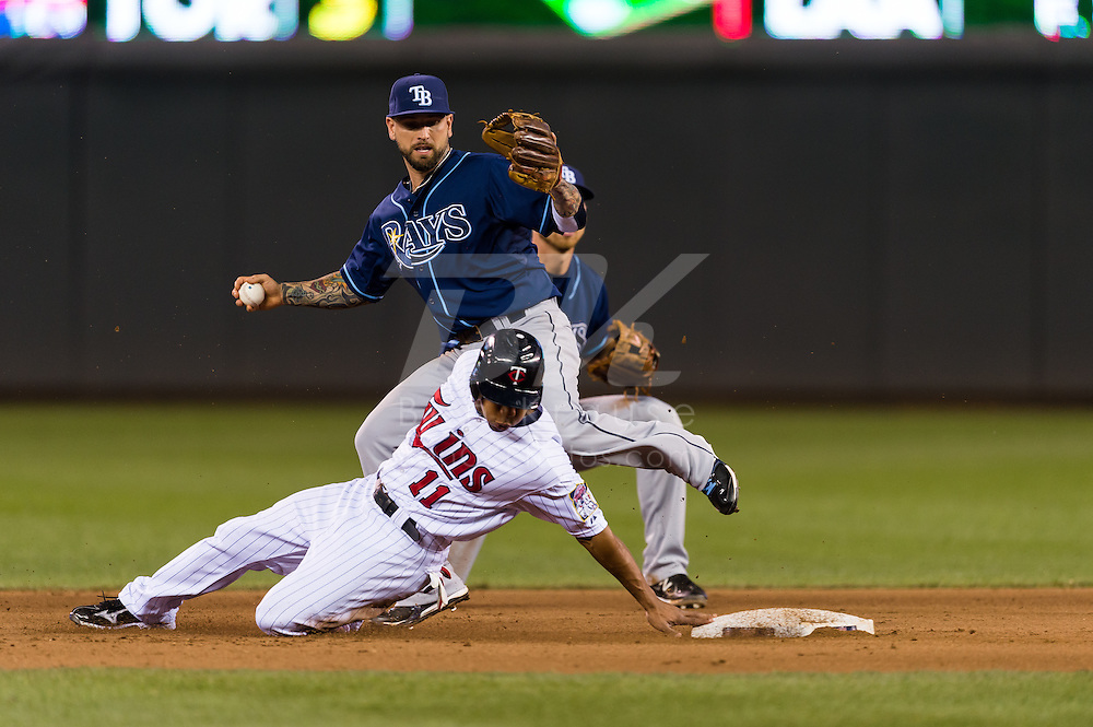 Ben Revere (11) of the Minnesota Twins slides past 2nd base with Ryan Roberts (19) of the Tampa Bay Rays behind him on August 10, 2012 at Target Field in Minneapolis, Minnesota.  The Rays defeated the Twins 12 to 6.  Photo: Ben Krause