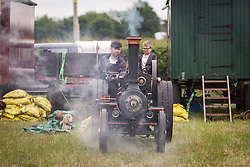 &copy; Licensed to London News Pictures. 29/05/17  ALTRINCHAM ,GREATER MANCHESTER,UK.  <br /> <br /> Ashley Hall Traction Engine Rally today (Monday 29th May 2017). The rally , hosted at Ashley Hall for the third year running , took place over the bank holiday weekend from Saturday 27th May until Sunday 29th May.<br /> John Macdonald Smith and son Hugo Macdonald Smith, nine. <br /> <br />   <br /> Photo credit: CHRIS BULL/LNP