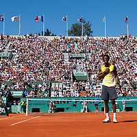30 May 2009: Gael Monfils of France celebrates following his victory during the Men's Singles third round match on day seven of the French Open at Roland Garros in Paris, France.